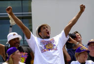 Los Angeles Lakers' guard Kobe Bryant gestures to the crowd from atop a doubledecker bus as the Lakers victory parade arrives at Staples Center in Los Angeles, June 21, 2000. Bryant, the 18-time NBA All-Star who won five championships and became one of the greatest basketball players of his generation during a 20-year career with the Los Angeles Lakers, died in a helicopter crash Sunday, Jan. 26, 2020. He was 41. (AP Photo/Nick Ut)