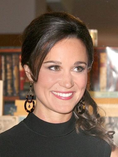 """<div class=""""caption-credit""""> Photo by: Getty Images</div><div class=""""caption-title"""">Pippa Middleton</div>For the British first sister's chic pony, smooth hair with a blow dryer and round brush, teasing the top to add volume. Create a smooth, side ponytail, and wrap a piece of hair around the elastic band. Use a curling iron on the part of the pony below the elastic. <br> <br> <b>More from REDBOOK:</b> <br> <ul>  <li>  <a rel=""""nofollow"""" target="""""""" href=""""http://www.redbookmag.com/beauty-fashion/tips-advice/winter-accessories?link=rel&dom=yah_life&src=syn&con=blog_redbook&mag=rbk""""><b>100 Cute, Affordable Winter Accessories</b></a>  </li>  <li>  <a rel=""""nofollow"""" target="""""""" href=""""http://www.redbookmag.com/beauty-fashion/tips-advice/celebrity-makeup-looks?link=rel&dom=yah_life&src=syn&con=blog_redbook&mag=rbk""""><b>The 50 Most Iconic Beauty Looks of All Time</b></a>  </li> </ul>"""