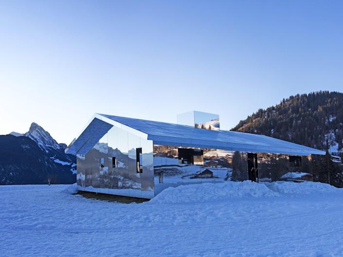 Mirage Gstaad by Doug Aitken sits in the snow in the Alps.