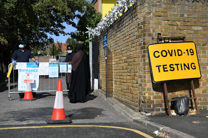People queue up outside a coronavirus testing centre offering walk-in appointments in east London. (Photo by Kirsty O'Connor/PA Images via Getty Images) (Photo: Kirsty O'Connor - PA Images via Getty Images)