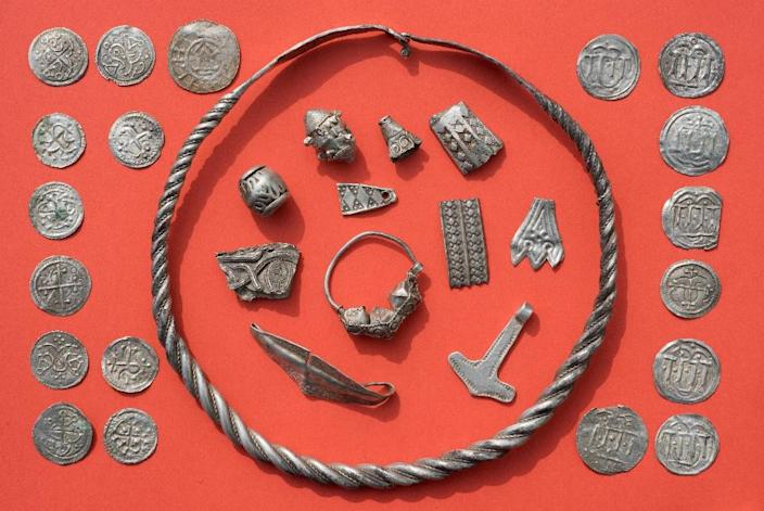 Braided necklaces, pearls, brooches, a Thor's hammer, rings and up to 600 chipped coins were found on Germany's northern Ruegen island (AFP Photo/Stefan Sauer)
