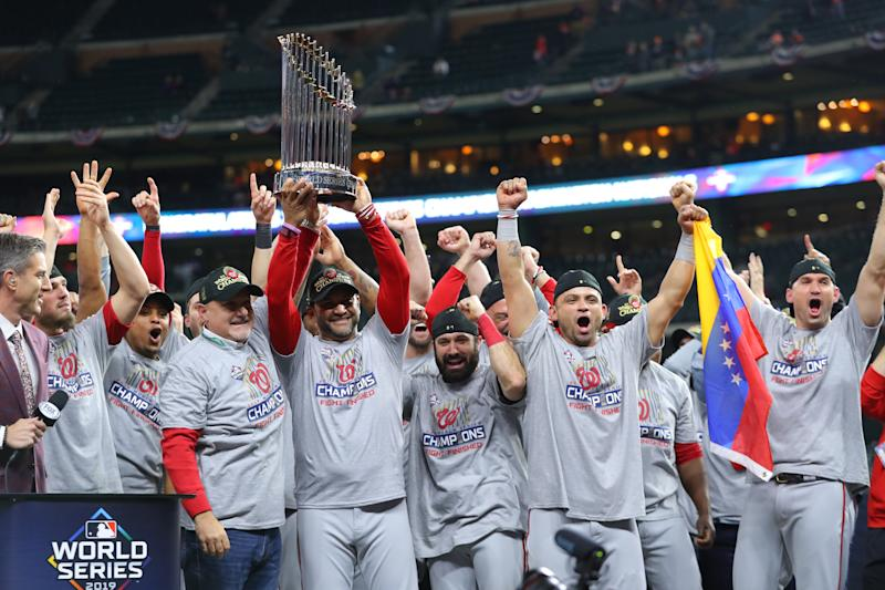HOUSTON, TX - OCTOBER 30: Washington Nationals general manager Mike Rizzo and manager Dave Martinez #4 hold up the World Series trophy after the Nationals defeat the Houston Astros in Game 7 to win the 2019 World Series at Minute Maid Park on Wednesday, October 30, 2019 in Houston, Texas. (Photo by Alex Trautwig/MLB Photos via Getty Images)