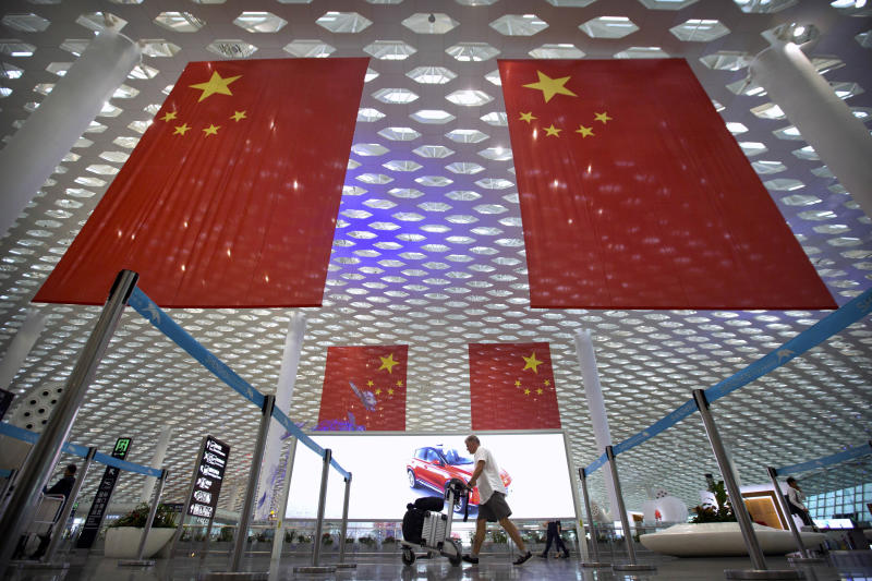 China issues travel alerts, slams US 'interference'