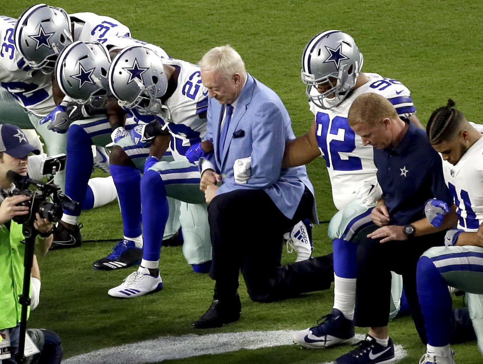 Last season, the Cowboys, led by owner Jerry Jones, center, took a knee prior to the national anthem before a Monday night game in Arizona. (AP)