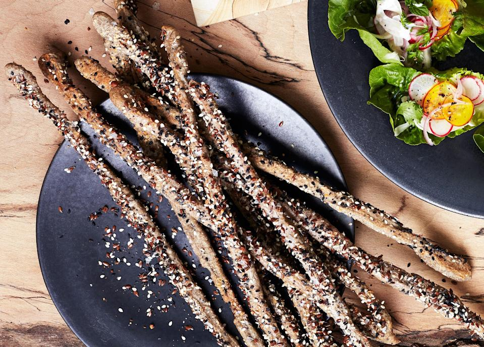 "Some of the seed mixture will inevitably fall off as you shape and bake the grissini; don't stress it. <a href=""https://www.bonappetit.com/recipe/seeded-buckwheat-grissini-with-parmesan?mbid=synd_yahoo_rss"" rel=""nofollow noopener"" target=""_blank"" data-ylk=""slk:See recipe."" class=""link rapid-noclick-resp"">See recipe.</a>"