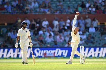India's Cheteshwar Pujara looks on as Australia's Nathan Lyon bowls on day one of the first test match between Australia and India at the Adelaide Oval in Adelaide, Australia, December 6, 2018. AAP/Dave Hunt via REUTERS