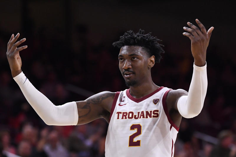 Southern California guard Jonah Mathews celebrates after scoring during the second half of an NCAA college basketball game against Washington, Thursday, Feb. 13, 2020, in Los Angeles. (AP Photo/Mark J. Terrill)