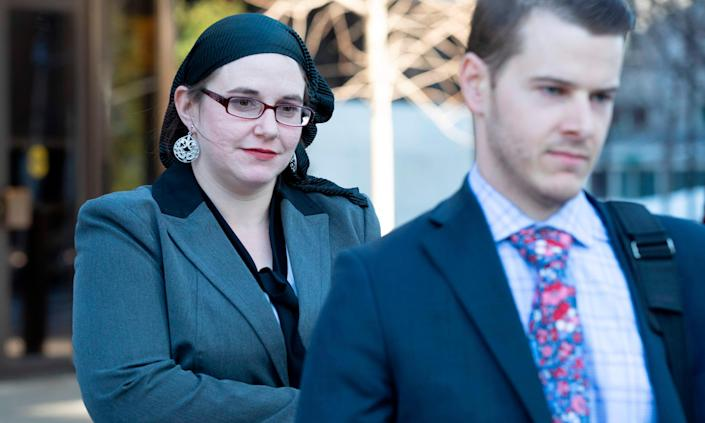 Caitlin Coleman leaves the Ottawa court house in Ottawa, Ontario, on Wednesday.