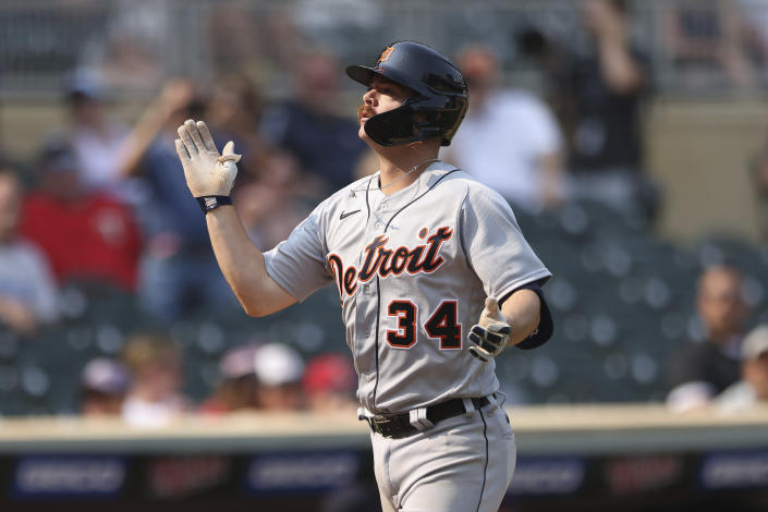 Detroit Tigers' Jake Rogers celebrates after hitting a grand slam to center field during the ninth inning of a baseball game against the Minnesota Twins, Sunday, July 11, 2021, in Minneapolis. (AP Photo/Stacy Bengs)