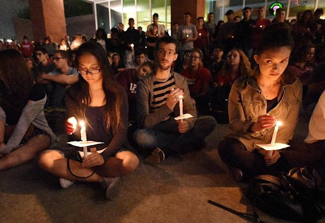 People attend a candlelight vigil at the University of Las Vegas student union the day after a gunman killed at least 58 people and wounded more than 500 others October 1 (AFP Photo/Robyn Beck)