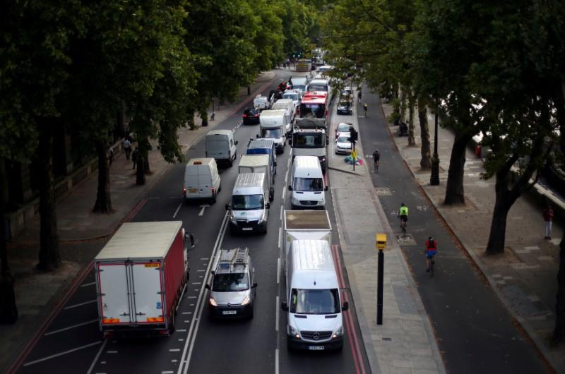 FILE PHOTO: Cars sit in a traffic jam along the Embankment during the morning rush hour in central London