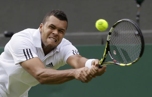 Jo-Wilfried Tsonga of France plays a return to Ernests Gulbis of Latvia during their Men's second round singles match at the All England Lawn Tennis Championships in Wimbledon, London, Wednesday, June 26, 2013. (AP Photo/Alastair Grant)