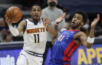Denver Nuggets guard Monte Morris (11) drives to the basket against Detroit Pistons forward Saddiq Bey (41) in the second quarter of an NBA basketball game in Denver, Tuesday, April 6, 2021. (AP Photo/Joe Mahoney)