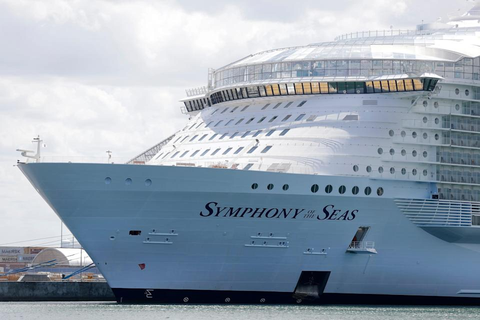 The Symphony of the Seas cruise ship is shown docked at PortMiami, May 20, 2020, in Miami.