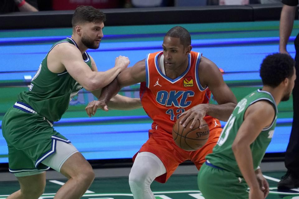Dallas Mavericks forward Maxi Kleber, left, defends as Oklahoma City Thunder center Al Horford (42) works to the basket during the first half of an NBA basketball game in Dallas, Wednesday, March 3, 2021. (AP Photo/Tony Gutierrez)