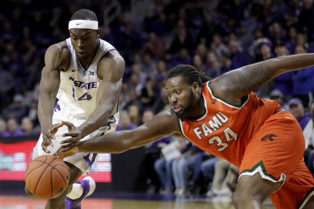 Kansas State's Makol Mawien (14) and Florida A&M's Levi Stockard II (34) chase the ball during the first half of an NCAA college basketball game Monday, Dec. 2, 2019, in Manhattan, Kan. (AP Photo/Charlie Riedel)