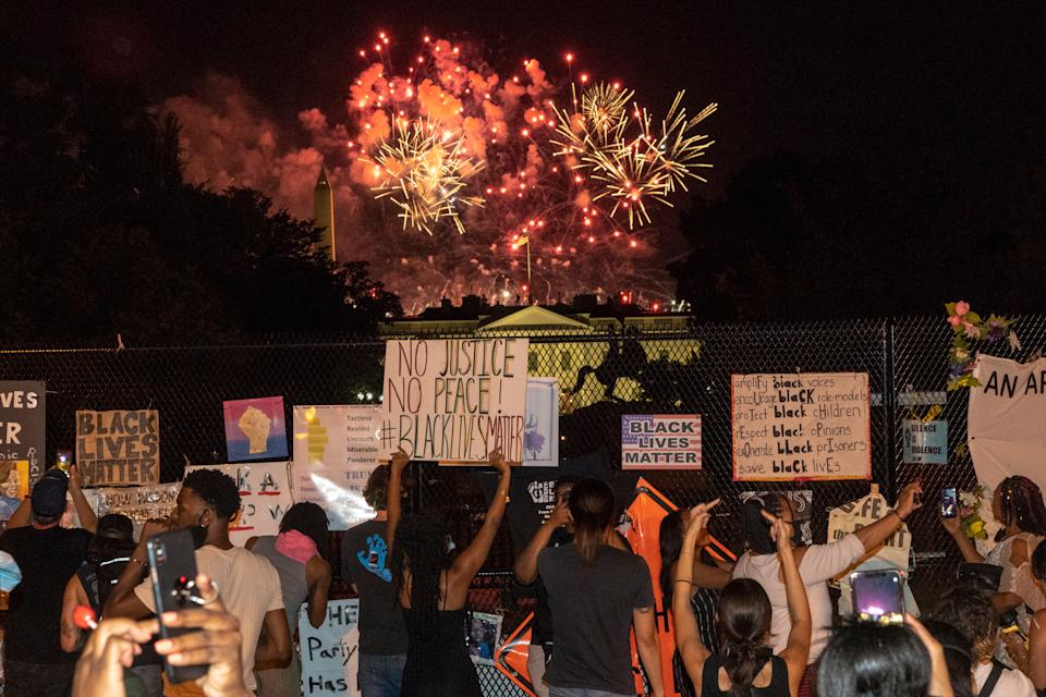 """Protestors gather at Black Lives Matter Plaza as fireworks explode above the Washington Monument on the fourth night of the Republican National Convention on Aug. 27<span class=""""copyright"""">Peter van Agtmael—Magnum Photos for TIME</span>"""