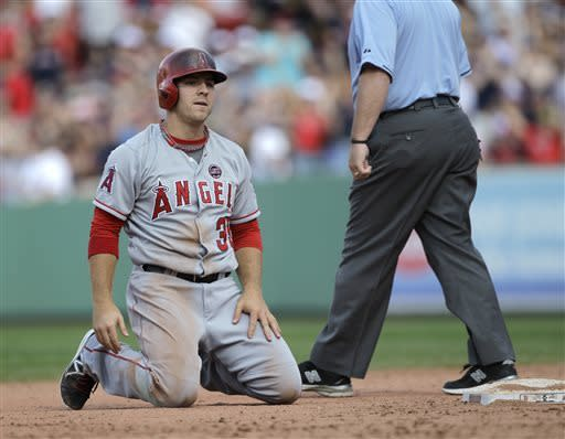 Los Angeles Angels player J.B. Shuck (39) reacts after getting caught out in a rundown between second and third during the eighth inning of a baseball game against the Boston Red Sox, Sunday, June 9, 2013 at Fenway Park in Boston. The Red Sox won, 10-5. (AP Photo/Mary Schwalm)