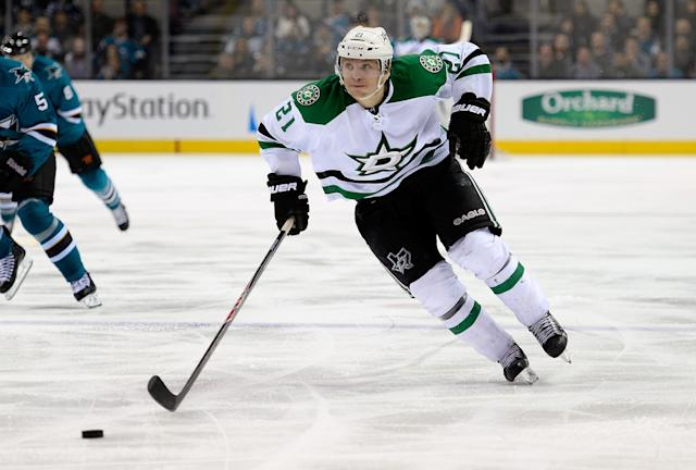 Antoine Roussel of the Dallas Stars skates up ice with control of the puck against the San Jose Sharks during the third period at SAP Center on December 21, 2013 in San Jose, California (AFP Photo/Thearon W. Henderson)