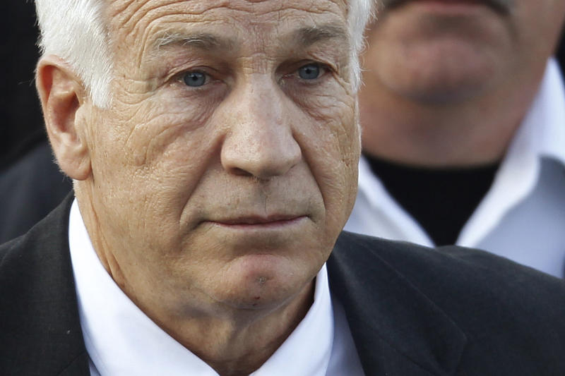 FILE - In this Dec. 13, 2011 file photo,Jerry Sandusky, the former Penn State assistant football coach charged with sexually abusing boys, leaves the Centre County Courthouse in Bellefonte, Pa. A young man who testified against Jerry Sandusky is suing Penn State, blaming the university for how its top officials dealt with complaints that the former assistant football coach was behaving inappropriately with boys. The lawsuit filed Friday, Aug. 24, 2012 by the man, called Victim 1 at Sandusky's trial, said Penn State officials made deliberate decisions not to report Sandusky to authorities.  (AP Photo/Matt Rourke, File)