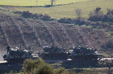 Turkish Army tanks are seen near the Turkish-Syrian border in Kilis province, Turkey January 31, 2018. REUTERS/Osman Orsal