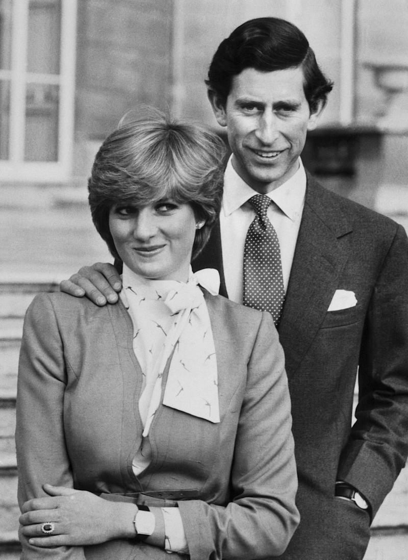 Prince Charles and Lady Diana Spencer pose outside Buckingham Palace following the official announcement of their engagement. Lady Diana, 19, had been a friend of the Royal Family all her life. Prince Charles, 32, was regarded as one of the world's most eligible bachelors. Photo courtesy of Getty Images.