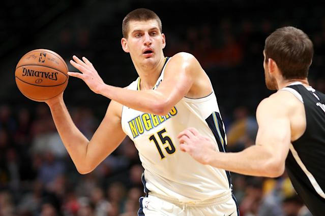 "<a class=""link rapid-noclick-resp"" href=""/nba/players/5352/"" data-ylk=""slk:Nikola Jokic"">Nikola Jokic</a> takes a moment to consider how he'd like to hurt the Nets next. (Getty)"