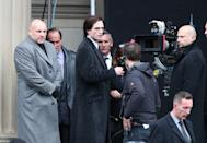 Actor Robert Pattinson (centre) on the set of The Batman in Liverpool wearing a coat which has been painted with the Riddler question mark.