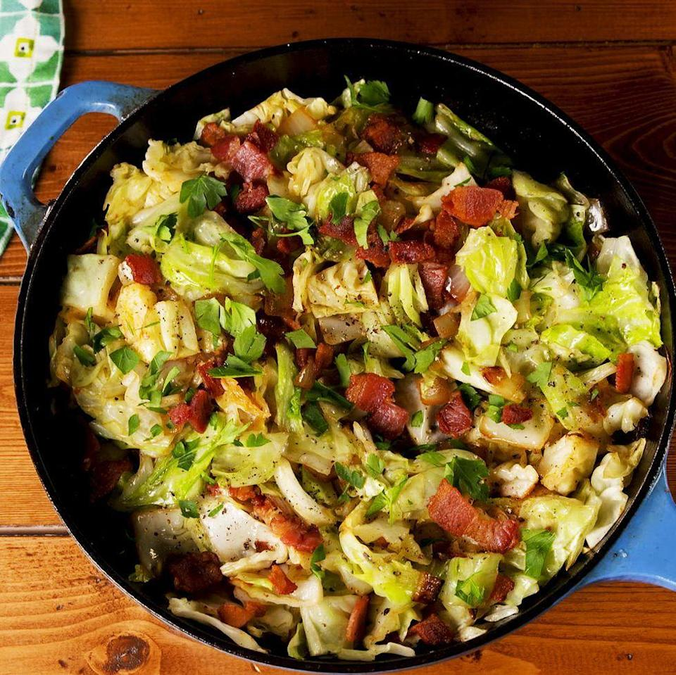 """<p>We like sautéing thick-cut bacon, then cooking <a href=""""https://www.delish.com/uk/cooking/recipes/a28782356/best-cabbage-soup-recipe/"""" rel=""""nofollow noopener"""" target=""""_blank"""" data-ylk=""""slk:cabbage"""" class=""""link rapid-noclick-resp"""">cabbage</a> in the bacon fat. If you're <a href=""""https://www.delish.com/uk/cooking/recipes/g29890255/vegetarian-recipes/"""" rel=""""nofollow noopener"""" target=""""_blank"""" data-ylk=""""slk:vegetarian"""" class=""""link rapid-noclick-resp"""">vegetarian</a>, simply swap out the bacon fat for a couple tablespoons of extra-virgin olive oil.</p><p>Get the <a href=""""https://www.delish.com/uk/cooking/recipes/a31110430/fried-cabbage-recipe/"""" rel=""""nofollow noopener"""" target=""""_blank"""" data-ylk=""""slk:Fried Cabbage"""" class=""""link rapid-noclick-resp"""">Fried Cabbage</a> recipe.</p>"""
