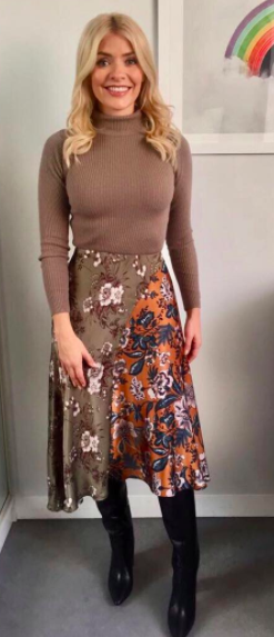 """<p>Holly teamed an oatmeal-hued <a rel=""""nofollow noopener"""" href=""""https://www.frenchconnection.com/product/woman-collections-jumpers-and-cardigans/78fzk/nicola-knits-high-neck-jumper.htm?clr=8c7b6c&utm_source=AWIN&utm_medium=affiliate&utm_term=0&utm_campaign=httpwwwstandardcouk&awc=3208_1509631676_8be5c944bd24e2dc4865db4088691600"""" target=""""_blank"""" data-ylk=""""slk:jumper"""" class=""""link rapid-noclick-resp"""">jumper</a> by French Connection with a <a rel=""""nofollow noopener"""" href=""""http://www.ghost.co.uk/chester-skirt-ruth-flower-sa01ck-p11?awc=7106_1509631757_2069d6f920e62f370b3ce3a13cf2d11a&utm_source=AWIN&utm_medium=222025&utm_campaign=Editorial+Content"""" target=""""_blank"""" data-ylk=""""slk:Ghost"""" class=""""link rapid-noclick-resp"""">Ghost</a> asymmetric skirt and boots by one of her favourite labels, <a rel=""""nofollow noopener"""" href=""""https://uk.maje.com/en/collection/shoes/foty/H17FOTY.html?dwvar_H17FOTY_color=0002&utm_source=Aw&awc=6879_1509631735_ce9a936d88f382eaeb2ff45573873260"""" target=""""_blank"""" data-ylk=""""slk:Maje"""" class=""""link rapid-noclick-resp"""">Maje</a>. </p>"""