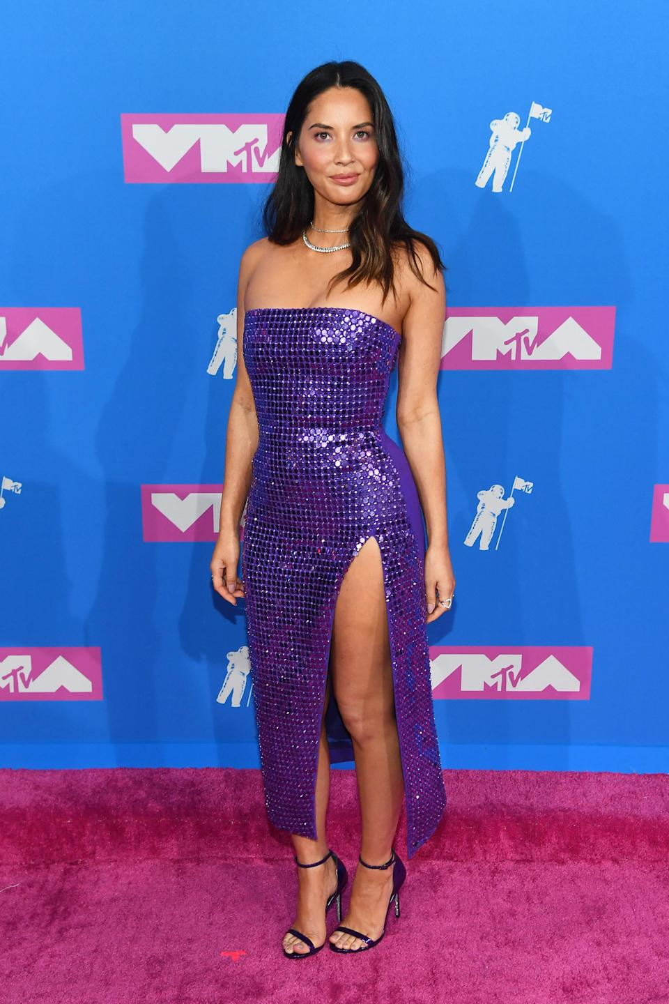 <p>Olivia paired her metallic David Koma dress with her purple eyeshadow for the annual awards show. [Photo: Getty] </p>