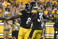 Pittsburgh Steelers defensive end Melvin Ingram (8) celebrates with free safety Minkah Fitzpatrick (39) after tackling Detroit Lions running back Dedrick Mills for a loss in the first half of an NFL preseason football game, Saturday, Aug. 21, 2021, in Pittsburgh. (AP Photo/Don Wright)