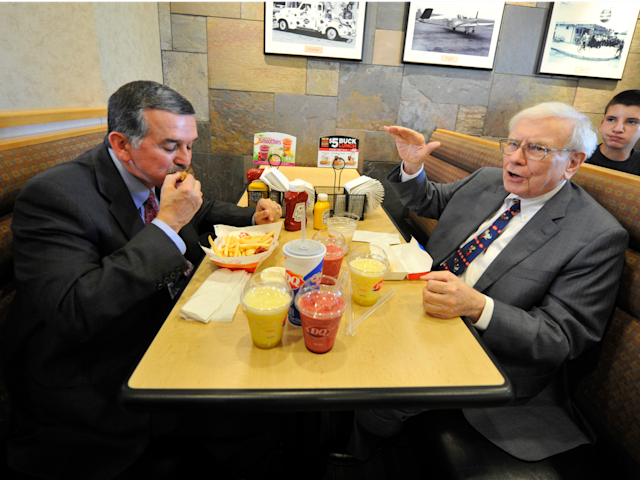 Warren Buffett eating lunch with John Gainor, then Dairy Queen's CEO, in 2013 in Omaha, Nebraska. The charity lunch will be much fancier than this. (AP)