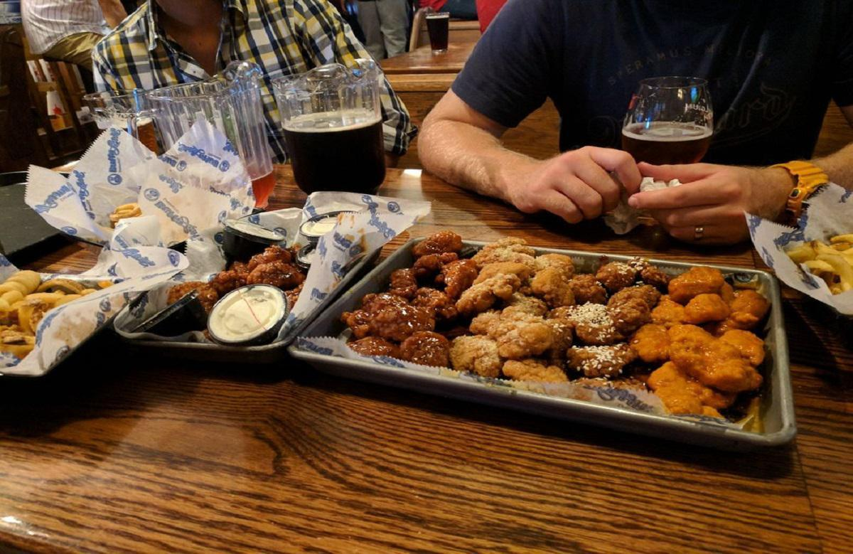 "<p>Located a stone's throw from Indiana University's campus since opening in 1987, BuffaLouie's is perpetually packed, and if anyone knows good wings, it's college students. Wings here are available in 17 homemade sauces, but stick with the straight-ahead Buffalo sauce. These wings are perfectly balanced, crispy, juicy and so easily washed down with <a href=""https://www.thedailymeal.com/drink/101-best-beers-america-gallery?referrer=yahoo&category=beauty_food&include_utm=1&utm_medium=referral&utm_source=yahoo&utm_campaign=feed"">one of the best beers in America</a>.</p>"