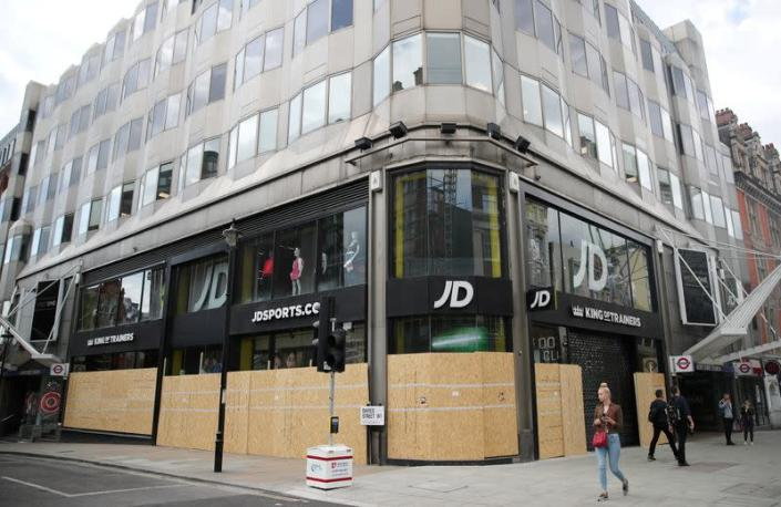 FILE PHOTO: Shops are seen boarded up in Oxford Street, in London
