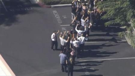 A still image from a video footage courtesy of Nbcla.com shows people lining up as first responders respond to shooting at the California Department of Developmental Services Inland Regional Center, one of 21 facilities serving people with developmental disabilities, in San Bernardino, California December 2, 2015. REUTERS/NBCLA.COM/Handout