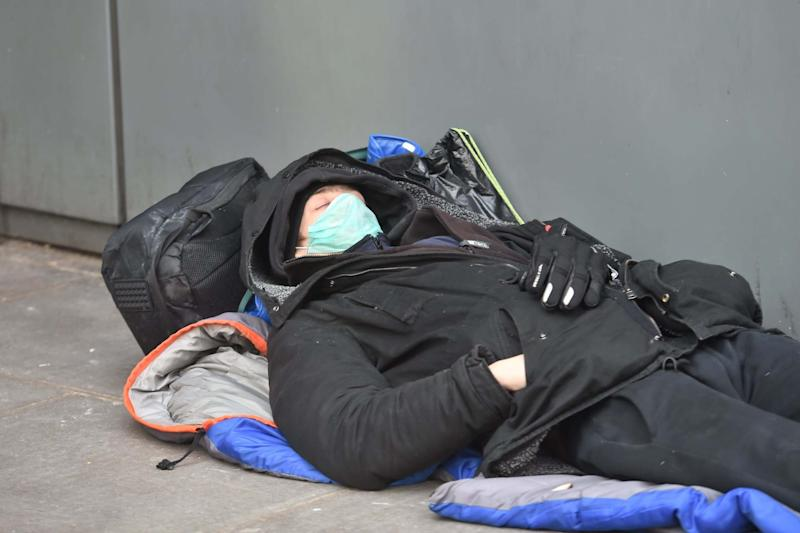 A man who appears to be homeless sleeping wearing a mask today in Victoria: Jeremy Selwyn