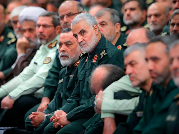 The head of the Revolutionary Guard's foreign wing, or Quds Force, Gen. Qassim Soleimani, center, attends a meeting of a group of the Guard members