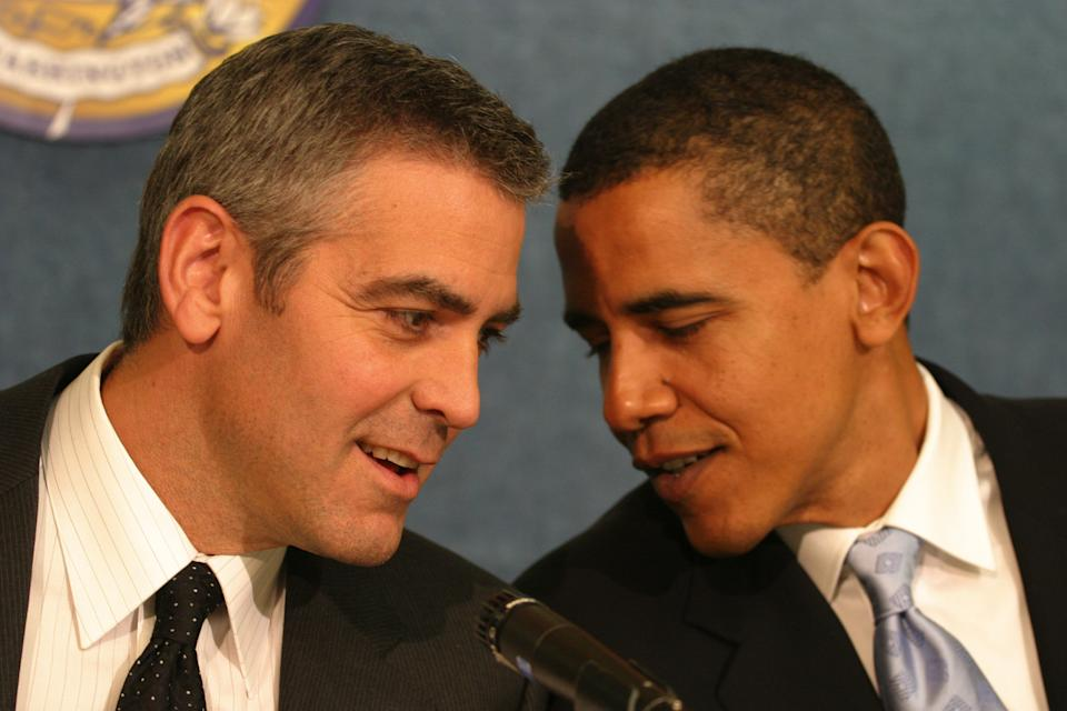 UNITED STATES - APRIL 27:  National Press Club's Newsmaker Program. Academy Award Winner George Clooney discusses his recent visit to War-torn darfur. And he released his video footage from his trip to Sudan with his father PICTURED: George Clooney, left, talks to Barack Obama, (D-IL) before the press conference.  (Photo by Sarah L. Voisin/Washington Post/Getty Images)