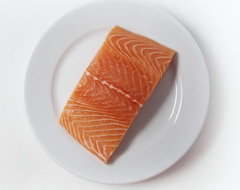 <p>We need to eat an optimal of 250mg of seafood omega-3 fats per day, found in salmon.<br /> (Picture: Rex) </p>