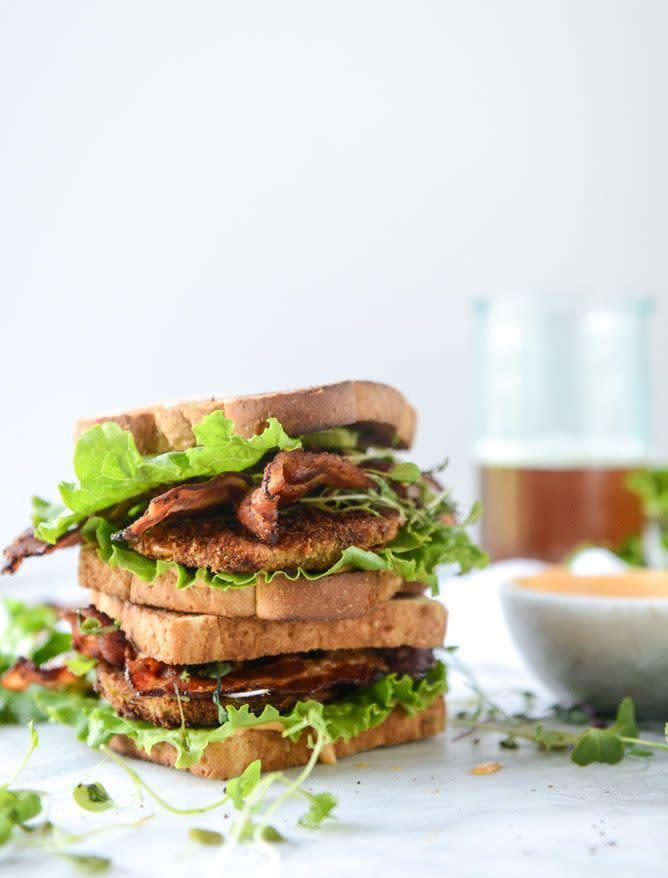 """<strong>Get the <a href=""""http://www.howsweeteats.com/2016/06/bacon-fried-green-tomato-blts-with-special-sauce/"""" rel=""""nofollow noopener"""" target=""""_blank"""" data-ylk=""""slk:Fried Green Tomato BLTs recipe"""" class=""""link rapid-noclick-resp"""">Fried Green Tomato BLTs recipe</a>&nbsp;from How Sweet It Is</strong>"""