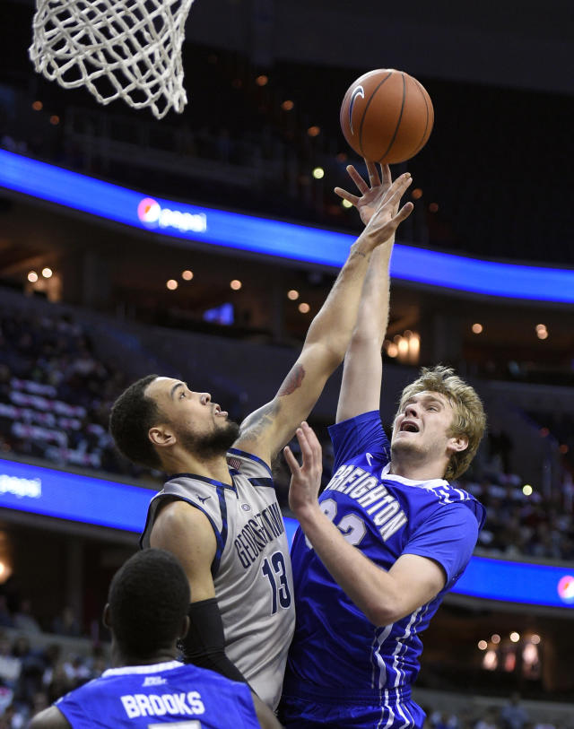 Creighton forward Toby Hegner, right, takes a shot against Georgetown forward Paul White (13) during the first half of an NCAA college basketball game, Saturday, Jan. 3, 2015, in Washington. (AP Photo/Nick Wass)