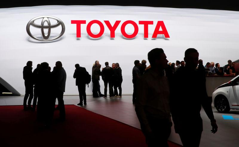 Visitors look at car models on the Toyota stand during the 88th Geneva International Motor Show in Geneva, Switzerland, March 7, 2018. REUTERS/Denis Balibouse