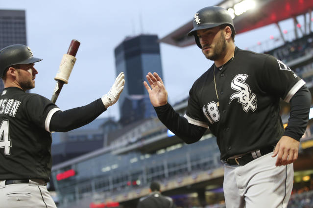 Chicago White Sox' Matt Davidson, left, congratulates Daniel Palka after he scored on a single by Omar Narvaez off Minnesota Twins pitcher Kyle Gibson in the first inning of a baseball game Saturday, Sept. 29, 2018, in Minneapolis. (AP Photo/Jim Mone)