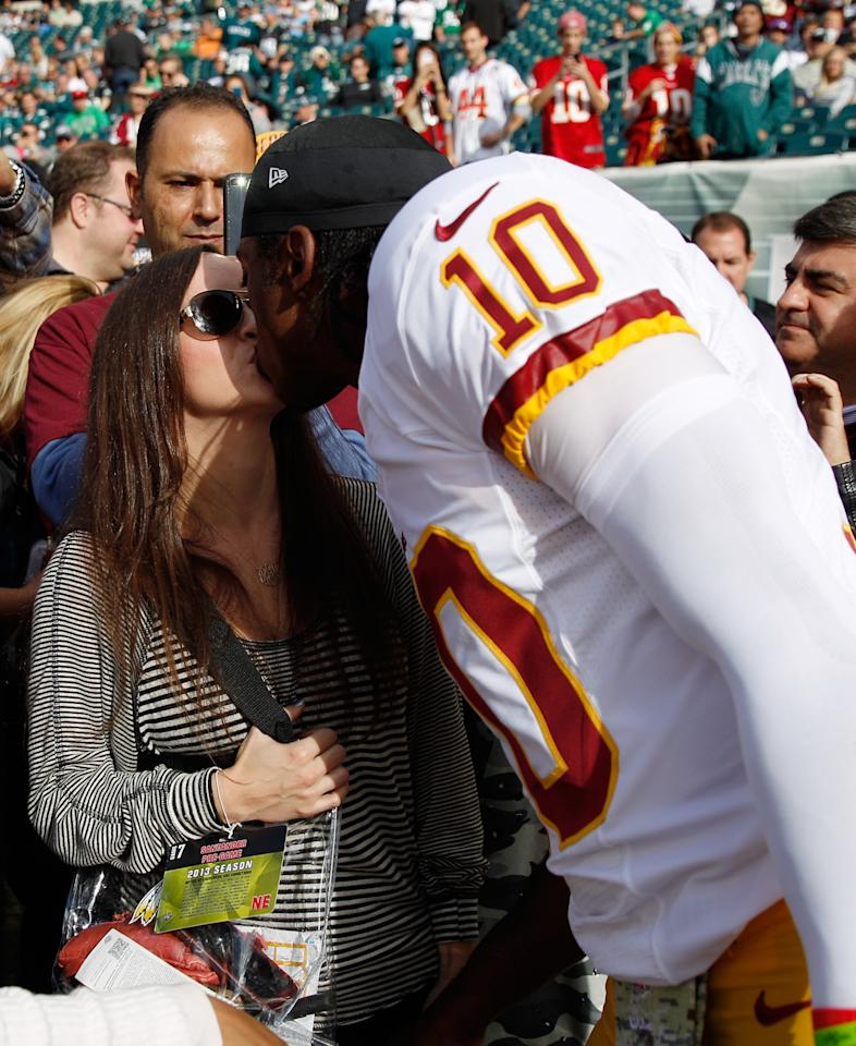 PHILADELPHIA, PA - NOVEMBER 17: Quarterback Robert Griffin III #10 of the Washington Redskins kisses his wife Rebecca Liddicoat before the start of the Redskins game against the Philadelphia Eagles at Lincoln Financial Field on November 17, 2013 in Philadelphia, Pennsylvania. (Photo by Rob Carr/Getty Images)