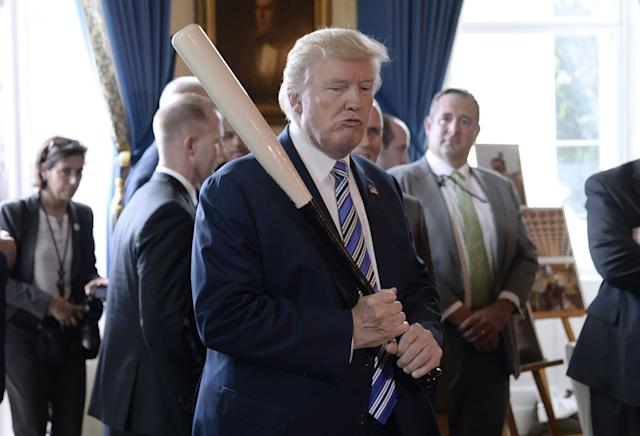 """Trump holding a Marucci baseball bat during a """"Made in America"""" product showcase event at the White House in July. Photographer: OLIVIER DOULIERY/AFP"""