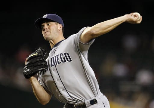 San Diego Padres' Clayton Richard throws against the Arizona Diamondbacks during the first inning of a baseball game, Monday, July 2, 2012, in Phoenix. (AP Photo/Ross D. Franklin)