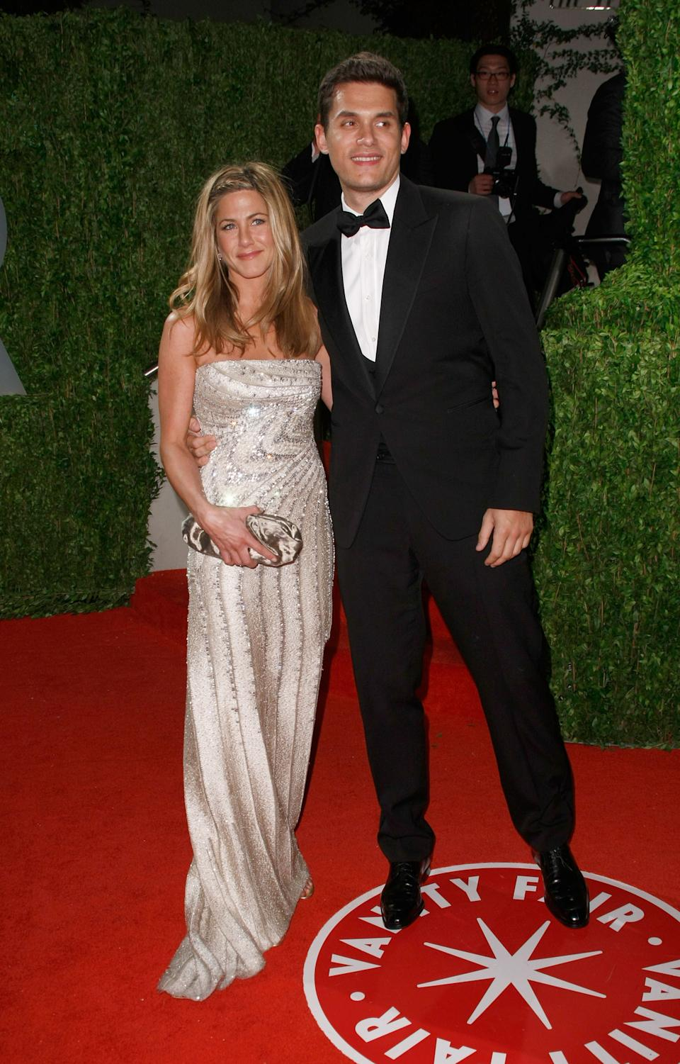 Aniston opted for a silver Valentino gown for her first red-carpet appearance with then-boyfriend John Mayer at the 2009 Vanity Fair Oscar Party. (Image via Getty Images)