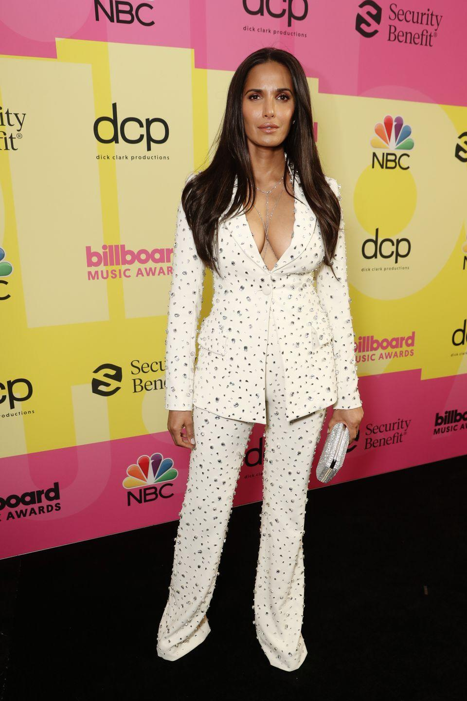 <p><strong>What:</strong> Christian Siriano <u><strong><strong><br></strong></strong></u><br><strong>Why:</strong> Showing off the blingy three-piece coordinate set on Instagram, Padma Lakshmi went with a less traditional (but equally opulent) tailored suit by the famed brand. She kept the accessories minimal and added a lariat-style necklace to accent the plunging neckline. Topping the look off with a glittered silver clutch and subtle makeup, she let the embellished outfit speak for itself. </p>