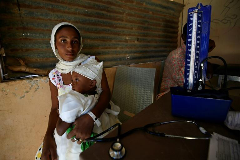 Tens of thousands of Ethiopians have fled fighting into neighbouring Sudan -- here a mother receives medical care at the Um Raquba refugee camp